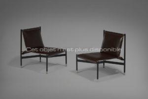 Paire de fauteuils, métal et cuir brun | Jacques Adnet