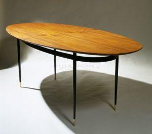 Grande table ovale, plaquée acajou, circa 1960 | Louis Sognot